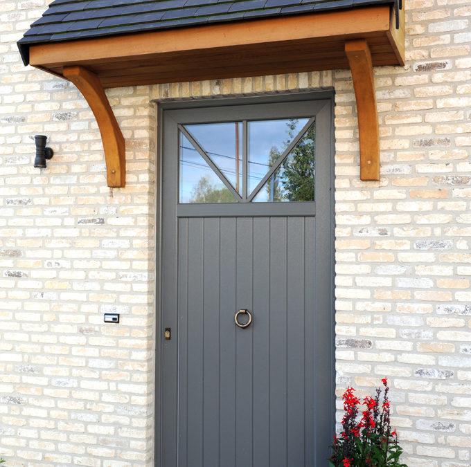 realisatiefoto deur in grijze pvc
